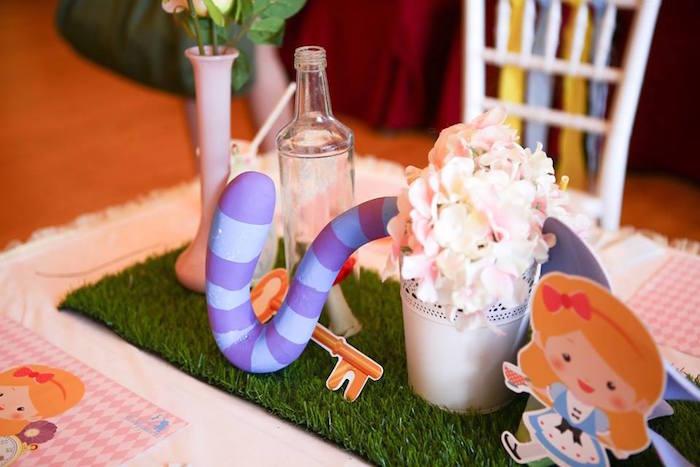 Table centerpieces from an Alice in Wonderland Birthday Tea Party via Kara's Party Ideas | KarasPartyIdeas.com (12)