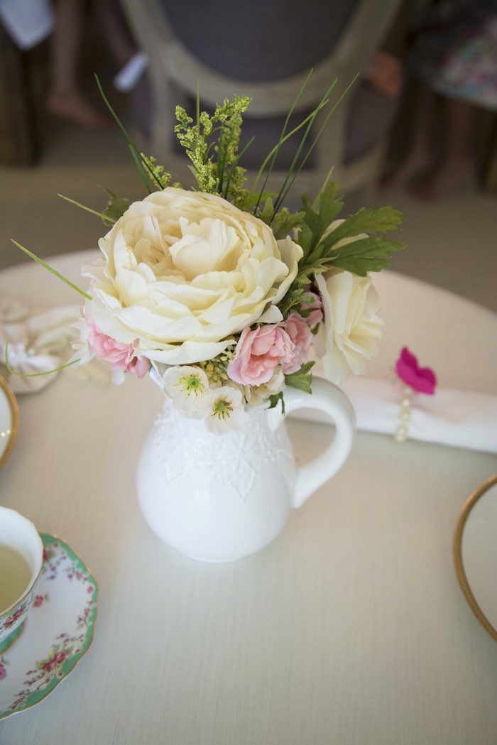 Flowers placed in a glass pitcher from a Colorful Tea Party via Kara's Party Ideas | KarasPartyIdeas.com (14)