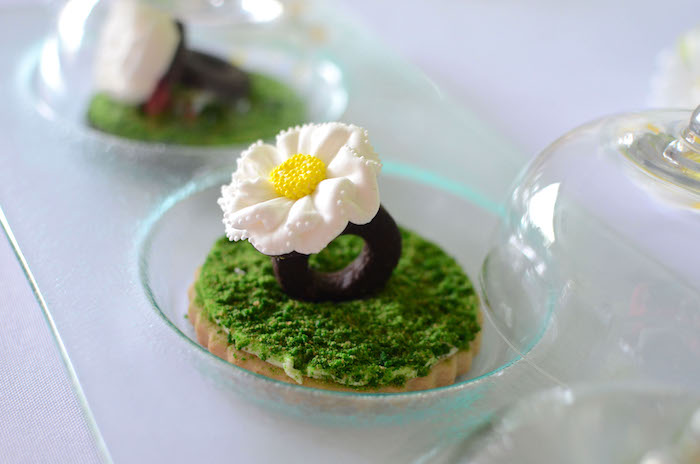 Daisy ring cookie atop moss from a Daisy Garden Themed Birthday Party via Kara's Party Ideas - KarasPartyIdeas.com (21)