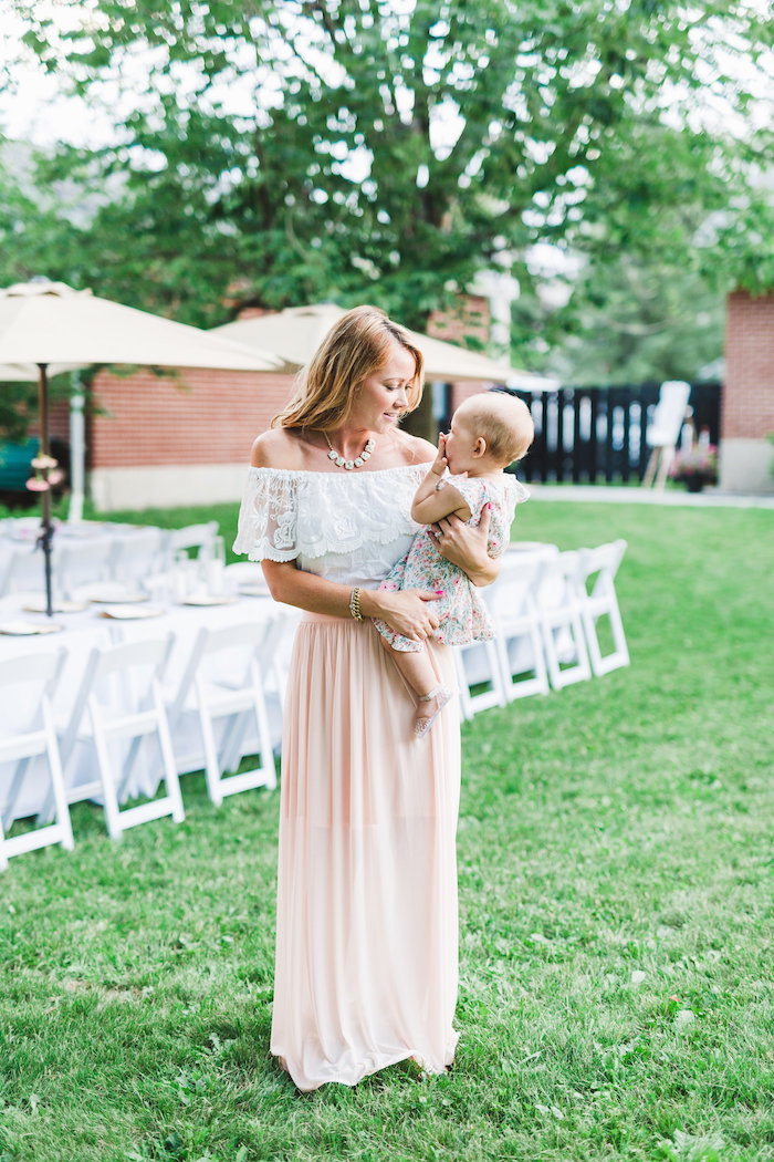 Candid photo of mom and baby from a Florals & Flamingos Birthday Party via Kara's Party Ideas KarasPartyIdeas.com (12)