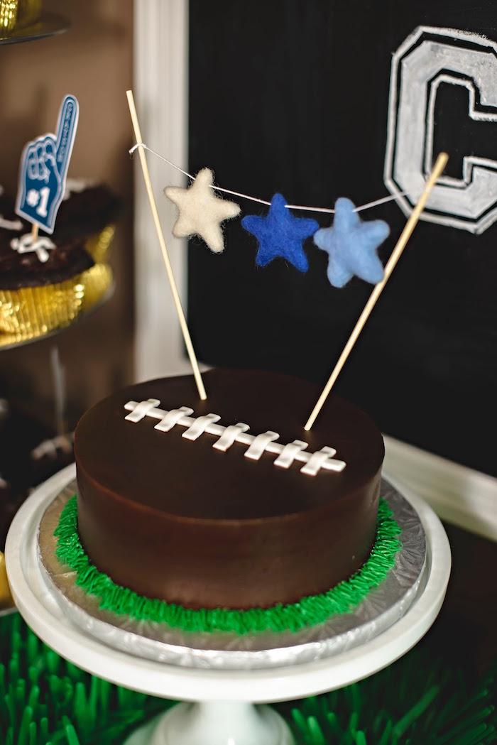 Football smash cake from a Football 1st Birthday Party via Kara's Party Ideas KarasPartyIdeas.com (20)