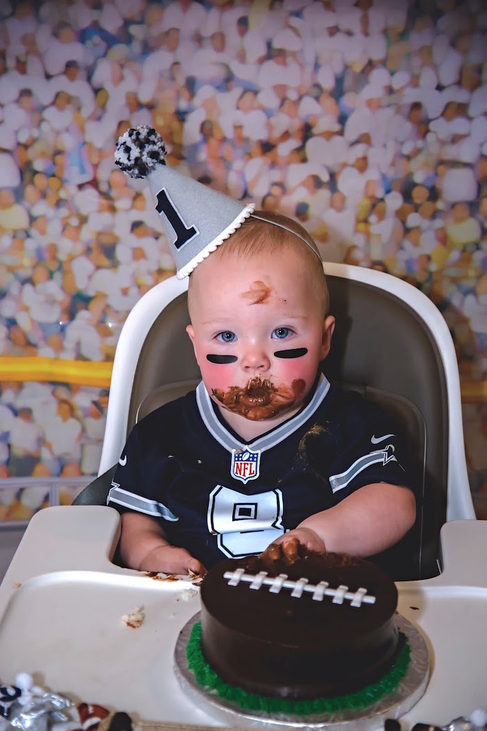 Dirty little football player after smash caking it at a Football 1st Birthday Party via Kara's Party Ideas KarasPartyIdeas.com (6)