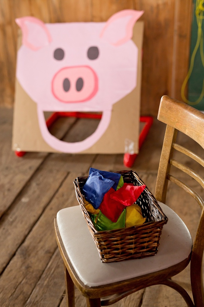 Feed the pig bean bag toss game from a Glamorous Barnyard Birthday Bash via Kara's Party Ideas | KarasPartyIdeas.com (18)