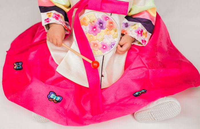Traditional dress detail worn by the birthday girl at a Japanese Cherry Blossom 1st Birthday Dol via Kara's Party Ideas | KarasPartyIdeas.com (5)