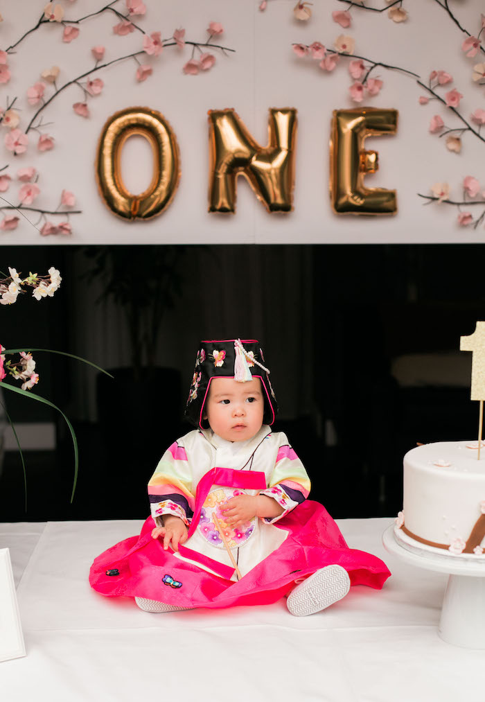 Birthday girl dressed in traditional attire from a Japanese Cherry Blossom 1st Birthday Dol via Kara's Party Ideas | KarasPartyIdeas.com (4)