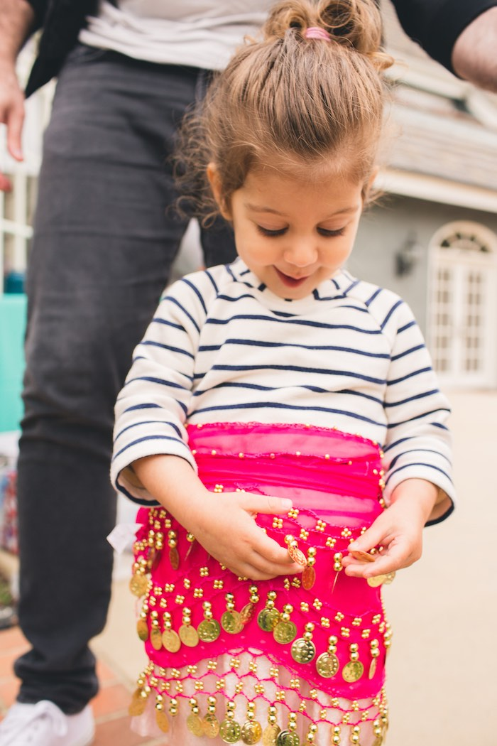 Little girl wearing a Moroccan hip scarf from a Moroccan Genie Party via Kara's Party Ideas | KarasPartyIdeas.com (12)