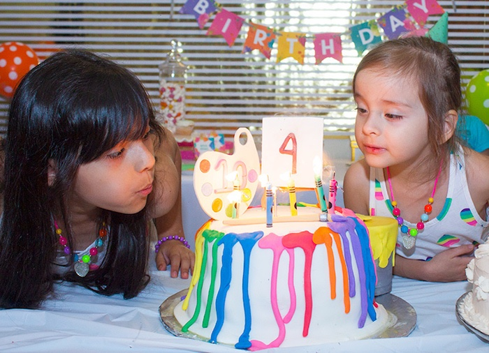 Blowing out the candles from a Neon Art Themed Birthday Party via Kara's Party Ideas KarasPartyIdeas.com (7)