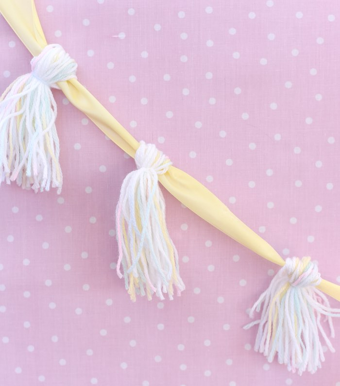 Unicorn tail tassel garland from a Pastel Unicorn Themed Birthday Party via Kara's Party Ideas | KarasPartyIdeas.com (14)