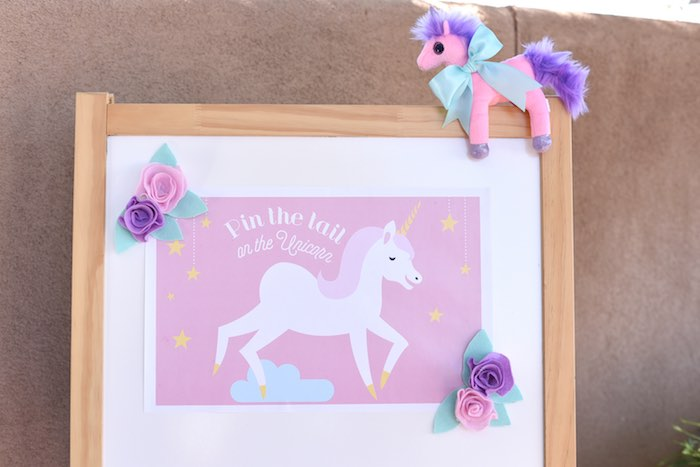 Pin the tail on the unicorn game from a Pastel Unicorn Themed Birthday Party via Kara's Party Ideas | KarasPartyIdeas.com (12)