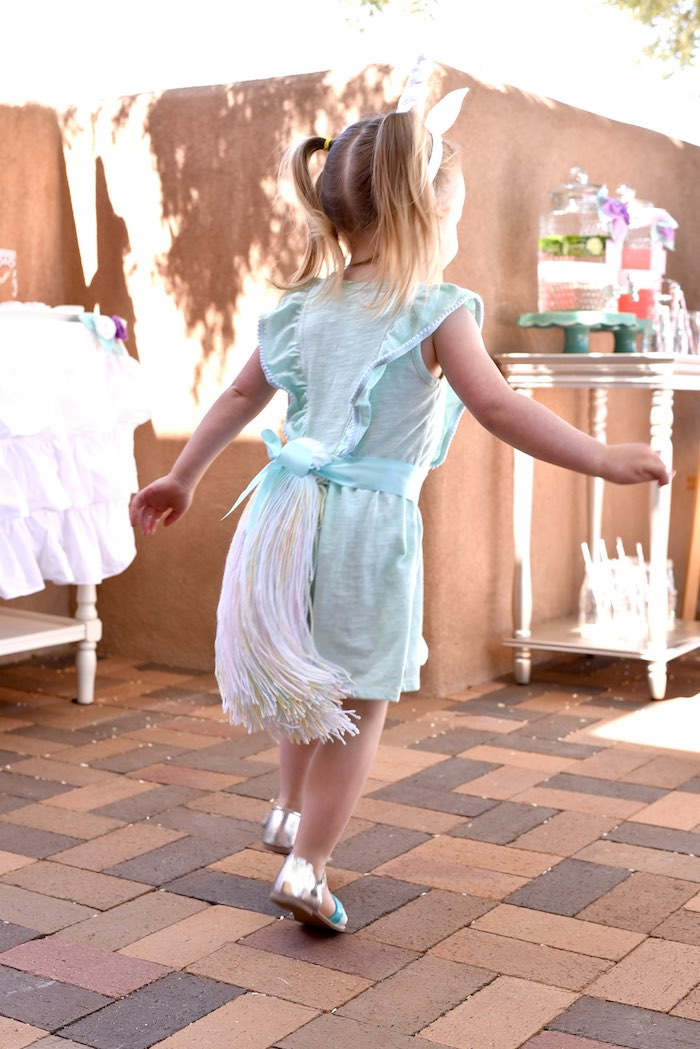 Unicorn at play from a Pastel Unicorn Themed Birthday Party via Kara's Party Ideas | KarasPartyIdeas.com (6)