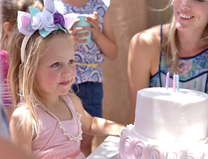 Birthday girl from a Pastel Unicorn Themed Birthday Party via Kara's Party Ideas | KarasPartyIdeas.com (5)