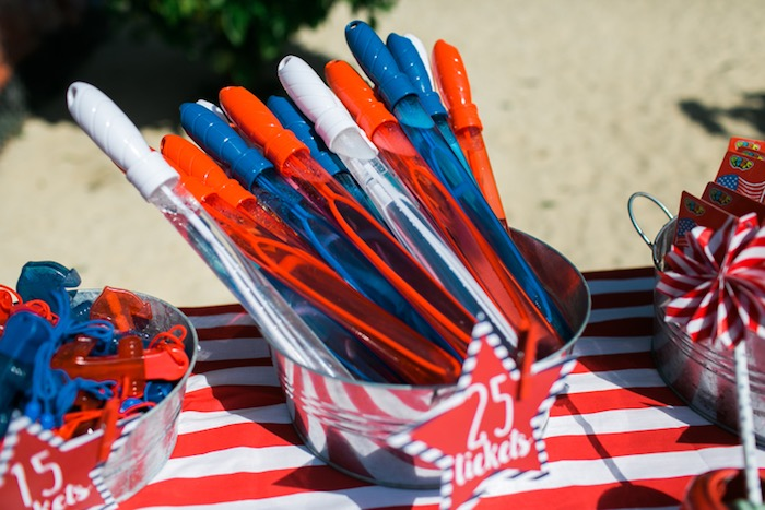 Bubble wands + prize table from a Patriotic Red + White & Blue Birthday BBQ via Kara's Party Ideas   KarasPartyIdeas.com (14)
