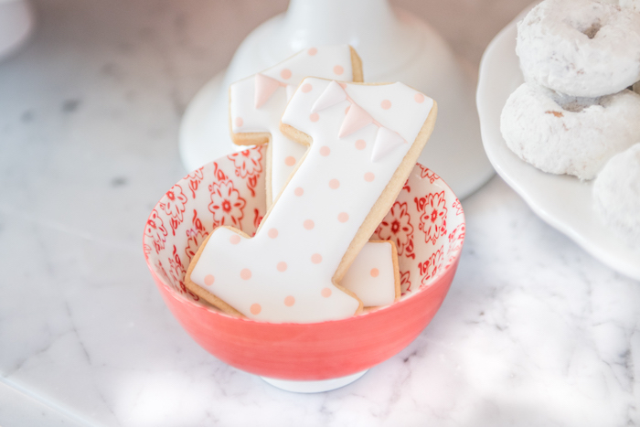 "Polka dot ""1"" cookies from a Peach + Coral Vintage Birthday Party via Kara's Party Ideas 