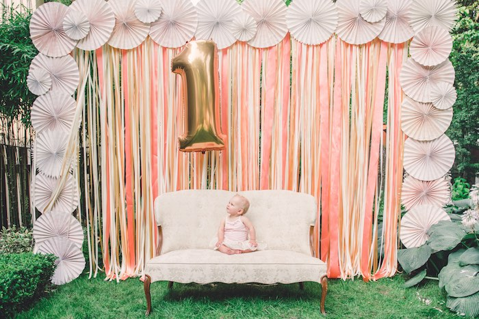 Photo Booth From A Peach Coral Vintage Birthday Party Via Karas Ideas