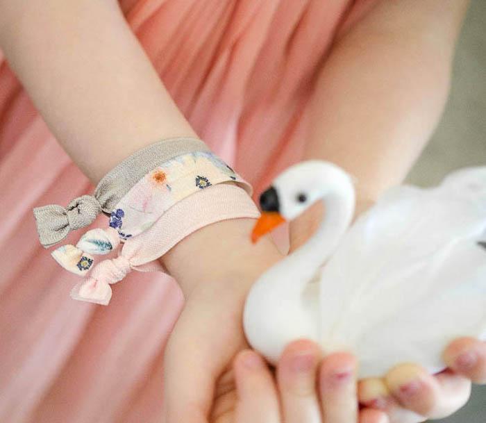 Hair tie favors + bracelets from a Sweet Swan Themed Birthday Party via Kara's Party Ideas | KarasPartyIdeas.com (24)