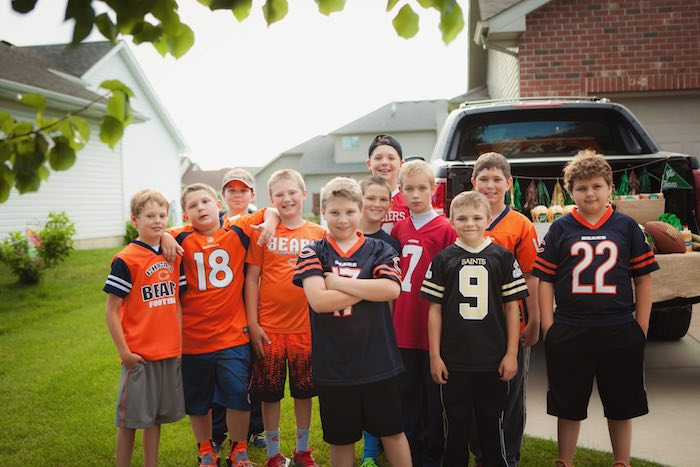 Football players + party guests from a Tailgate Football Birthday Party via Kara's Party Ideas | KarasPartyIdeas.com | The place for all things Party! (4)