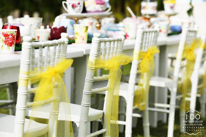 Chair backs tied with yellow tulle from a Vintage Alice in Wonderland Birthday Tea Party on Kara's Party Ideas KarasPartyIdeas.com (45)