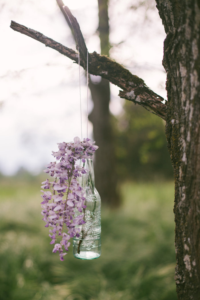 Hanging glass bottle floral arrangement from a Whimsical Rustic Floral Wedding via Kara's Party Ideas KarasPartyIdeas.com (27)