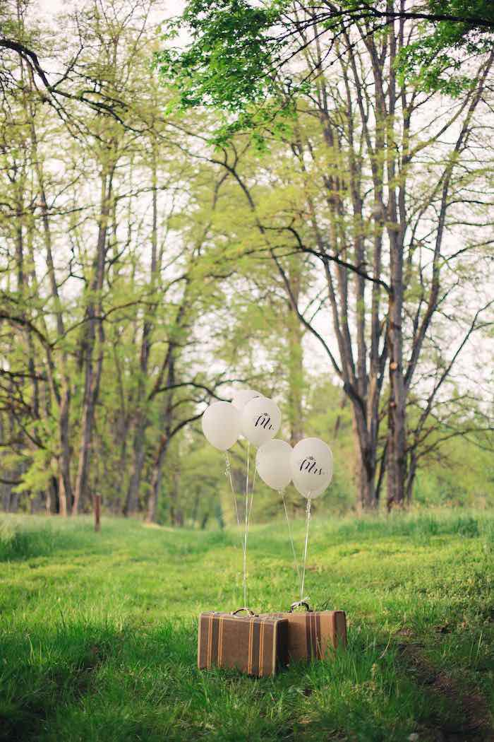 Vintage suitcases & floating balloons from a Whimsical Rustic Floral Wedding via Kara's Party Ideas KarasPartyIdeas.com (25)