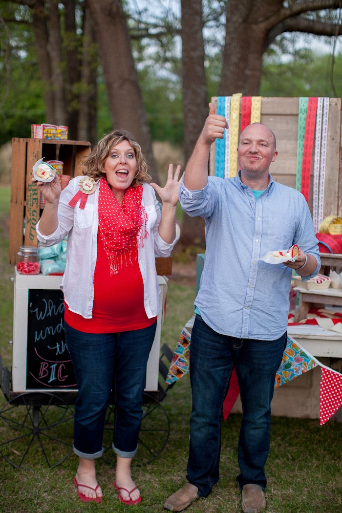 The reveal from a Carnival Themed Gender Reveal Party via Kara's Party Ideas | KarasPartyIdeas.com (9)