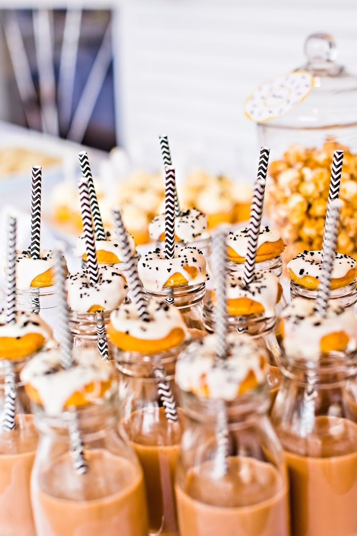 Drink bottles topped with mini donuts from a Donut Birthday Bash on Kara's Party Ideas | KarasPartyIdeas.com (18)