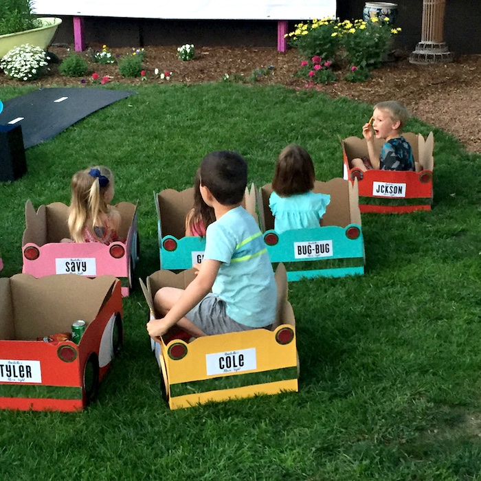Kids in cardboard cars from a Drive In Movie Night Birthday Party via Kara's Party Ideas | KarasPartyIdeas.com (4)