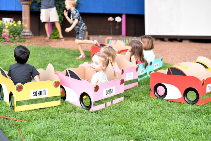 Kids in cardboard cars from a Drive In Movie Night Birthday Party via Kara's Party Ideas | KarasPartyIdeas.com (3)