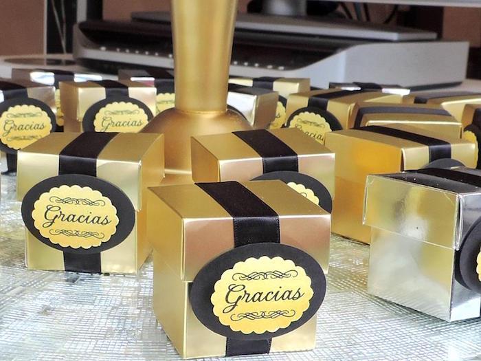 Gold favor boxes from a Fabulous 50 Black & Gold Birthday Party via Kara's Party Ideas | KarasPartyIdeas.com (9)