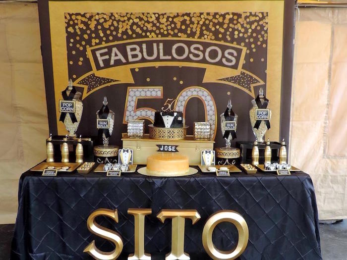 dessert table from a fabulous 50 black gold birthday party via karas party ideas