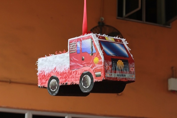 Firetruck piñata from a Firefighter Birthday Party via Kara's Party Ideas | KarasPartyIdeas.com (18)