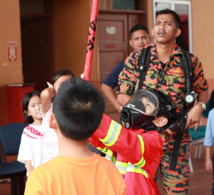 Piñata fun from a Firefighter Birthday Party via Kara's Party Ideas | KarasPartyIdeas.com (12)