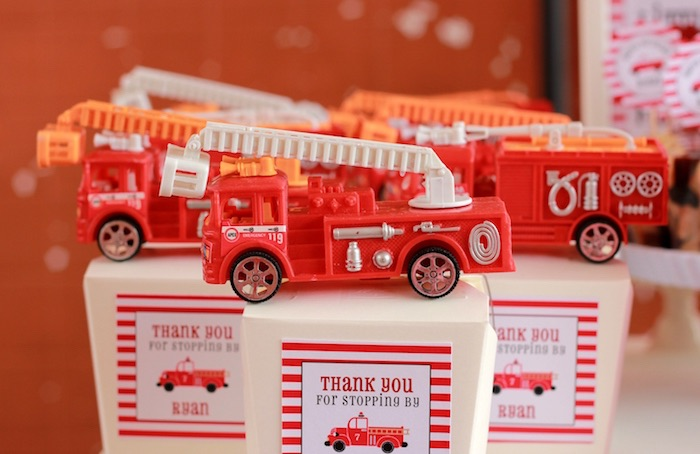 Firetruck favors + boxes from a Firefighter Birthday Party via Kara's Party Ideas | KarasPartyIdeas.com (9)