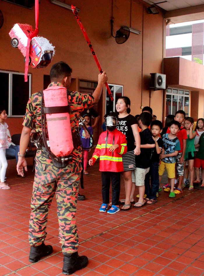 Firetruck piñata from a Firefighter Birthday Party via Kara's Party Ideas | KarasPartyIdeas.com (21)