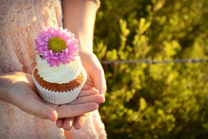 Cupcake in-hand from a Floral Bohemian Sunset Party on Kara's Party Ideas | KarasPartyIdeas.com (13)