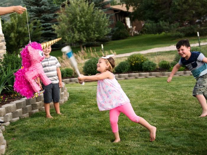 Unicorn piñata from a Glamorous Unicorn Birthday Party via Kara's Party Ideas KarasPartyIdeas.com (6)