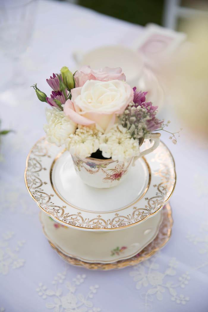 Tea cup floral arrangement set atop china from a Laduree Tea Party at Kara's Party Ideas | KarasPartyIdeas.com (29)