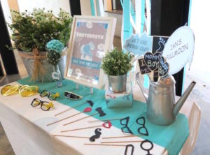 photo booth prop table from a modern elephant baby shower via kara s