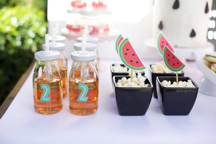 Popcorn and juice bottles from a One in a Melon Watermelon Birthday Party via Kara's Party Ideas KarasPartyIdeas.com (5)