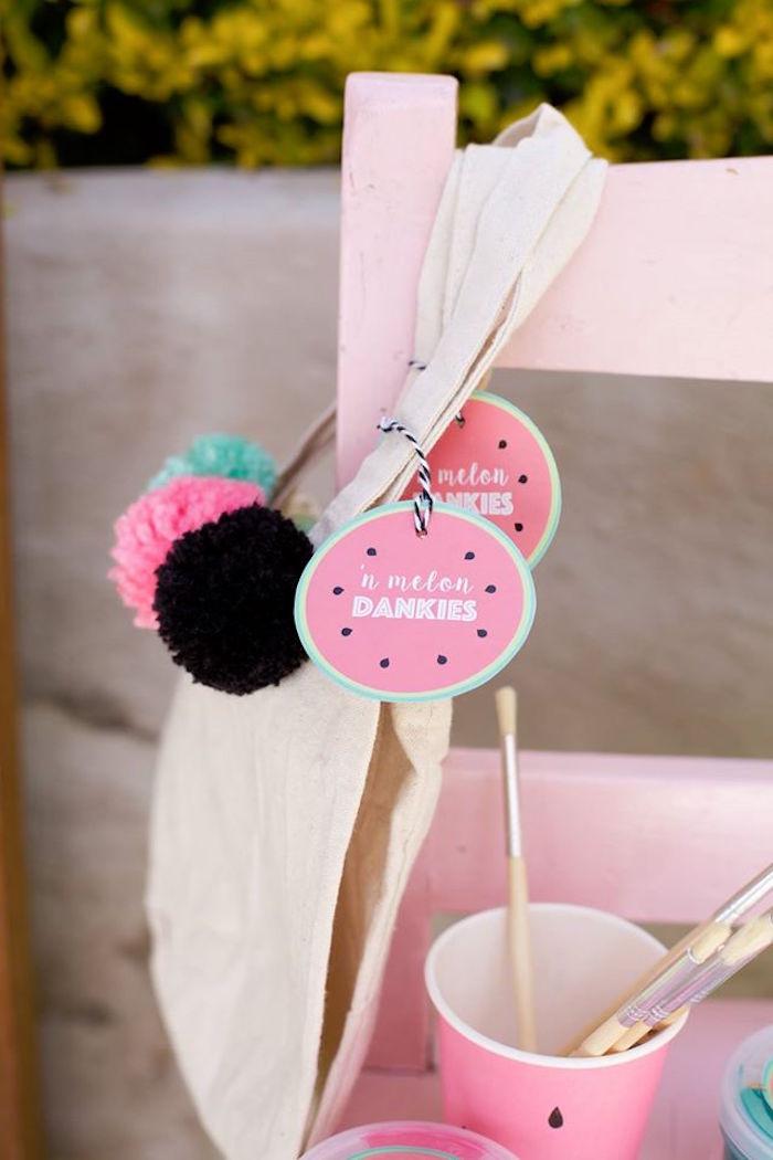 Pom pom favor bags from a One in a Melon Watermelon Birthday Party via Kara's Party Ideas KarasPartyIdeas.com (14)