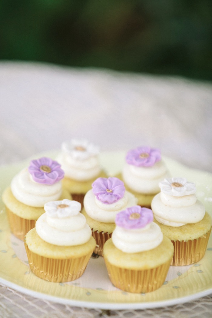 Mini cupcakes topped with flowers from an Outdoor Vintage Tea Party on Kara's Party Ideas | KarasPartyIdeas.com (18)