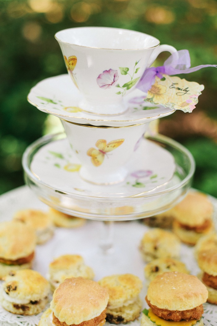 Stacked tea cups + saucers table centerpiece from an Outdoor Vintage Tea Party on Kara's Party Ideas | KarasPartyIdeas.com (35)
