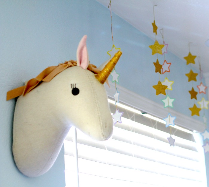 Plush unicorn head + star bunting from a Pastel Iridescent Unicorn 2nd Bday Party on KarasPartyIdeas.com (18)