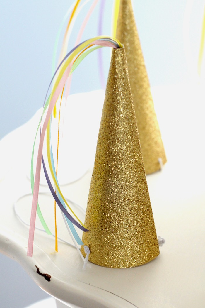 Unicorn party hat from a Pastel Iridescent Unicorn 2nd Bday Party on KarasPartyIdeas.com (11)