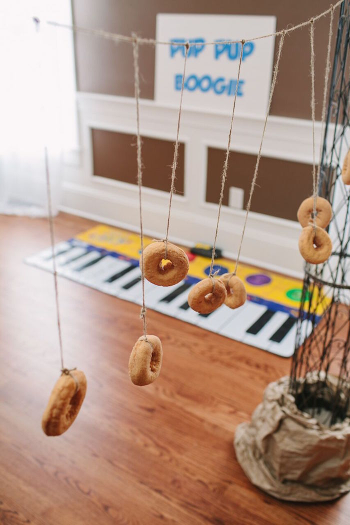 Doughnuts strung on a string from a Paw Patrol Themed Birthday Party via Kara's Party Ideas KarasPartyIdeas.com (14)