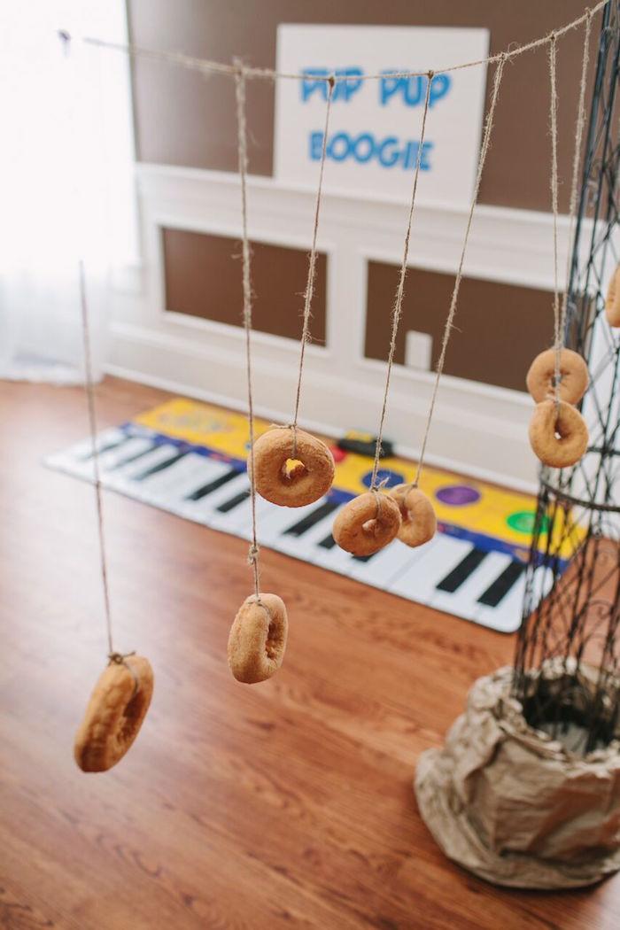 Doughnuts strung on a string from a Paw Patrol Themed Birthday Party via Kara's Party Ideas KarasPartyIdeas.com (14)