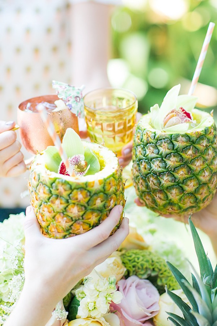 Drinks served in pineapples from a Pineapple Garden Party via Kara's Party Ideas | KarasPartyIdeas.com (20)