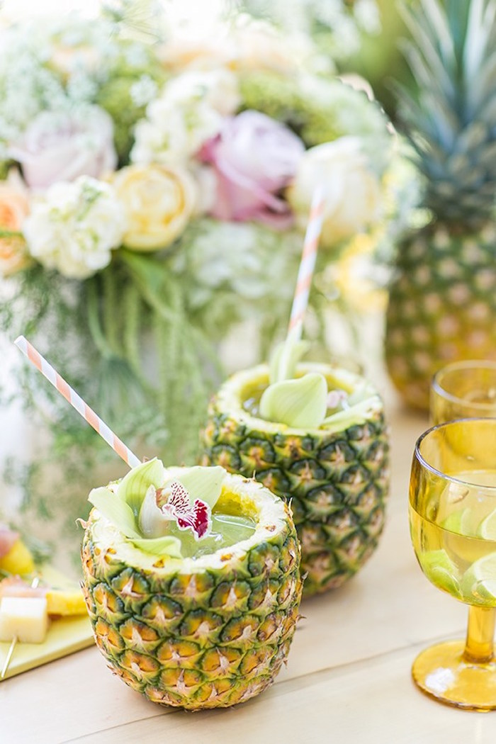 Pineapple Mojitos served in pineapples from a Pineapple Garden Party via Kara's Party Ideas | KarasPartyIdeas.com (19)