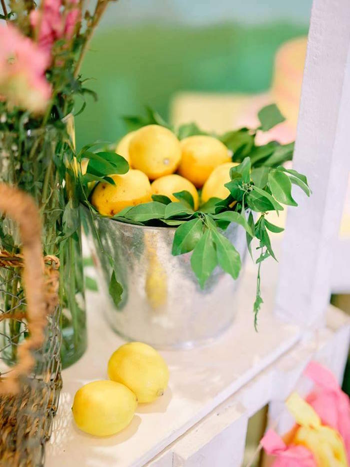 Bucket of lemons from a Pink Lemonade Birthday Party via Kara's Party Ideas   KarasPartyIdeas.com (23)