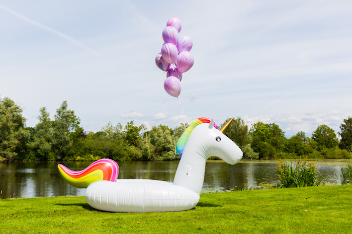 Unicorn float tube from a Rainbow Unicorn Birthday Party via Kara's Party Ideas | KarasPartyIdeas.com (8)