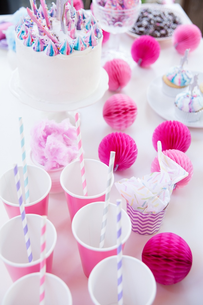 Pink paper cups and honeycomb balls from a Vibrant Unicorn Party on Kara's Party Ideas | KarasPartyIdeas.com (13)